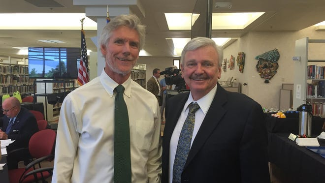 Newly elected chair of the Nevada Board of Regents Rick Trachok and DRI President Stephen Wells take a break from the Nevada Board of Regents meeting at Truckee Meadows Community College Thursday June 11, 2015.
