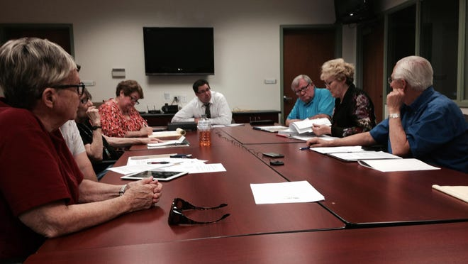 The Ad-Hoc incentive committee meets to discuss the process of city-owned land.