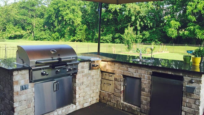 A custom-built outdoor kitchen makes summer entertaining a snap at the home of Kris and Bryan Whitt.