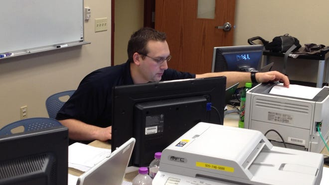 Sturgeon Bay Police Sgt. Carl Waterstreet taking part in the 2013 Internet Crimes Against Children Investigation Operation Black Veil.