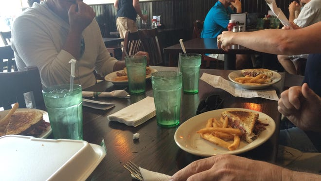 Food tour participants dig in at Eddie O'Briens in Canandaigua.