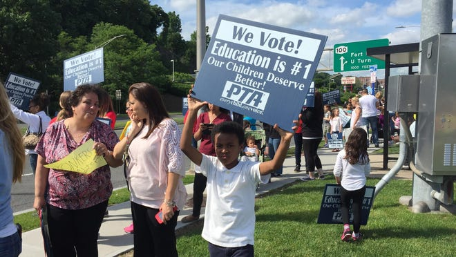 Parents and students from three Yonkers schools rallied June 3 off Central Park Avenue to protest looming cuts to school programs and staff.