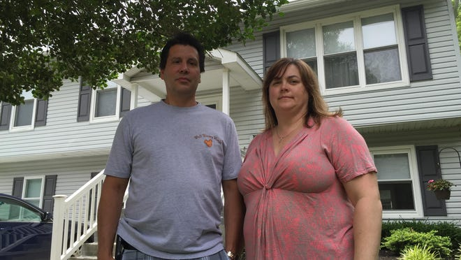 Tony and Tanya Algozzini at their Barnegat home, which they fear will lose value if apartments are built across the street.