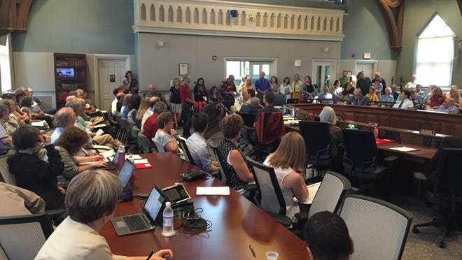 About 60 people packed the meeting chambers to standing room only on Tuesday night. The majority of speakers said they supported the Franklin Properties proposal, which seeks to develop a mixed-use space with some condominiums.