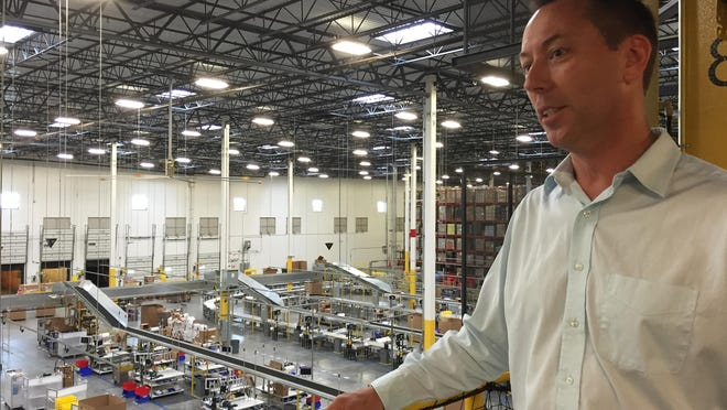 Tim Hall, manager of Amazon's fulfillment center in Robbinsville, gives a tour of the 1.2 million-square-foot facility on Friday.