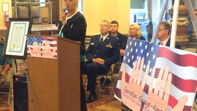 Lisa Naslund shares her son Dillion's story about taking his own life because of Post-Traumatic Stress Disorder at the Operation Engage America resource fair Saturday, June 20, at the State Capitol rotunda.
