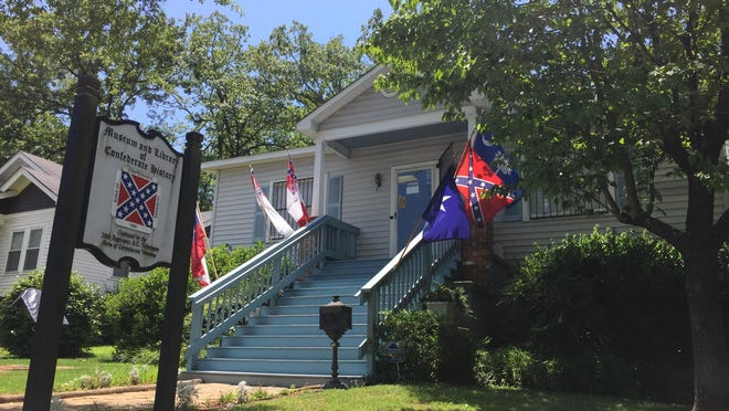 Flags fly outside the Museum and Library of Confederate History in Greenville.