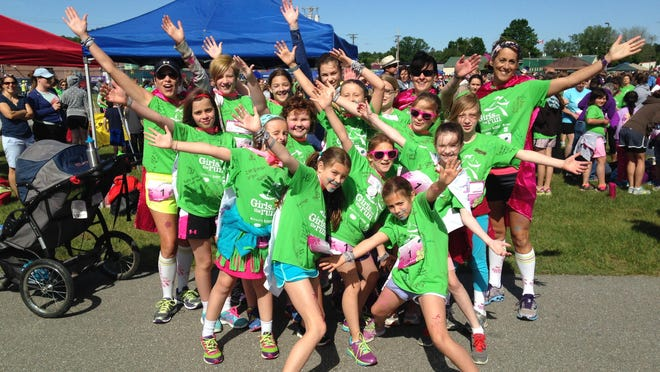 Students from the Mater Christi School in Burlington pose for a photo at the Girls on the Run 5K event.