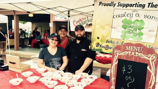 The staff at John Cowley & Sons prepared and served 500 portions of strawberry shortcake to benefit the farmers market last weekend.
