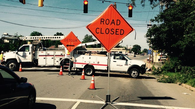 Crews on Wednesday work on Philadelphia Pike, which was closed between Schoolhouse Lane and Duncan Road in the Bellefonte area following an intense storm. Thousands were left without power.