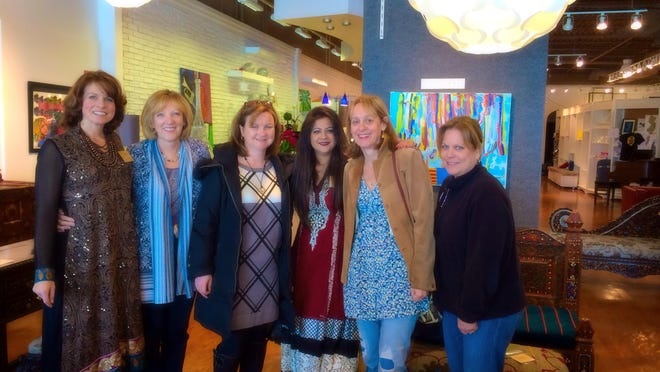 Nazia Zaidi (third from right) with friends at Nazia's Eastern Interiors show in Chester.