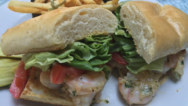 Through summer at Wild River Grille, any two dishes on the weekday lunch menu are $20. The sautéed shrimp sandwich is like shrimp scampi on a bun.