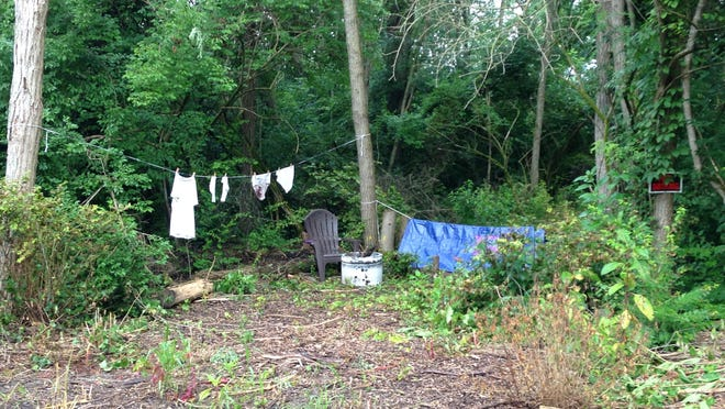 A camp site appeared overnight along Petty Road in Muncie.