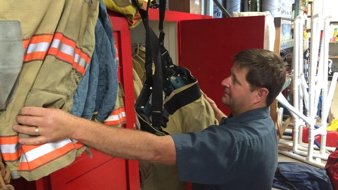 Southern Door Fire Captain Tim Rollin examines some of the gear that firefighters are currently using on the job.