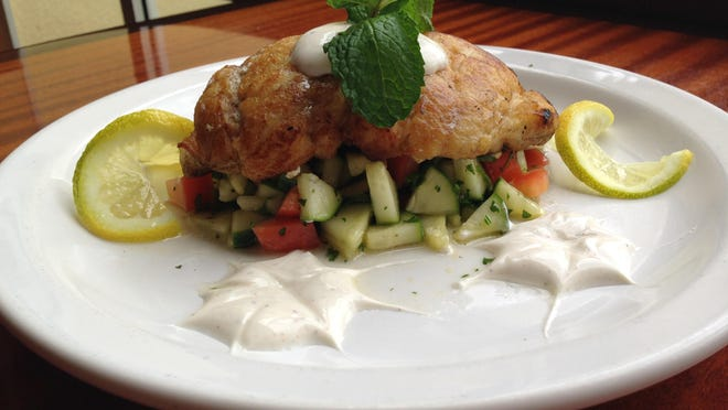 Summer grouper, served over a cucumber tomato relish with spicy yogurt at The Prawnbroker in Fort Myers.