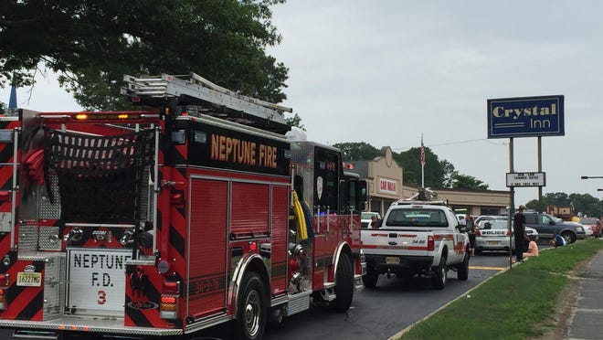 Neptune fire officials respond to a fire at the Crystal Inn on Route 35.