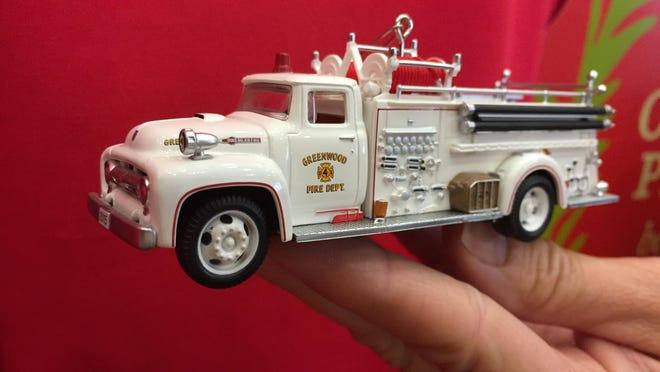 Teresa Dillard, owner of Teresa's Hallmark, holds the new Hallmark Keepsake ornament modeled after a 1956 Greenwood Fire Department truck. The real truck will be at Dillard's Greenwood shop when the ornament is officially unveiled on Saturday.