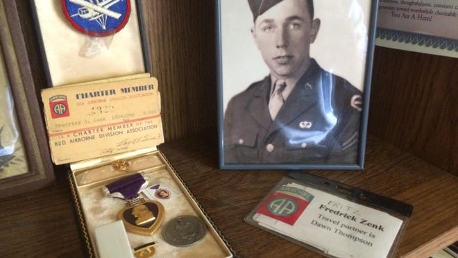 """A shelf in Sheboygan resident Fredrick """"Fritz"""" Zenk's home is lined with mementos from his service as a paratrooper in World War II."""