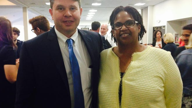 Newly elected Michigan Democratic Party chair Lavora Barnes, right, and former party chair Brandon Dillon.