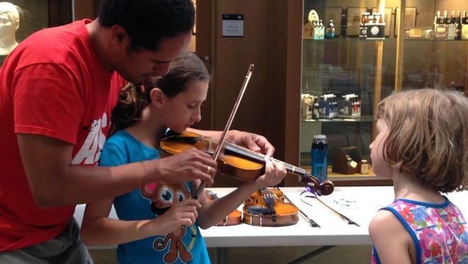 Oscar Soler is a viola instructor with the Aber Suzuki Center. Soler was available at the open house on Saturday so kids could try out the viola and learn some basics.