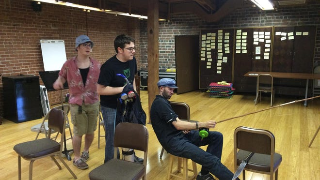 """Think they need a bigger boat? Actors Eli DePriest, Spencer Tilley and Sean Parker rehearse their parts for """"JAWS: A Parody."""" A humorous take on the classic horror film, the parody opens Thursday in downtown Springfield."""