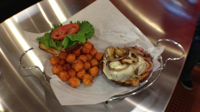 A portobello sandwich with sweet potato tater tots at Punch Burger.