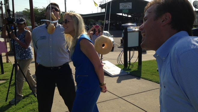 From right to left: Chris Alexander, Jinny Ballard and A.J. Massey bob for donuts during Rise and Shine.