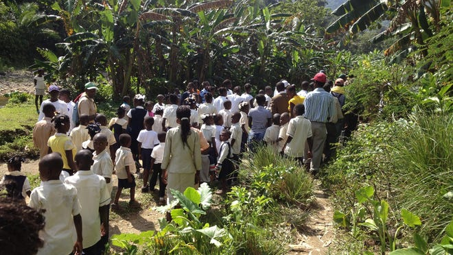 People head to a ceremony celebrating the opening of a school in Borgne, Haiti, which is supported by the nonprofit organization Friends of Borgne.