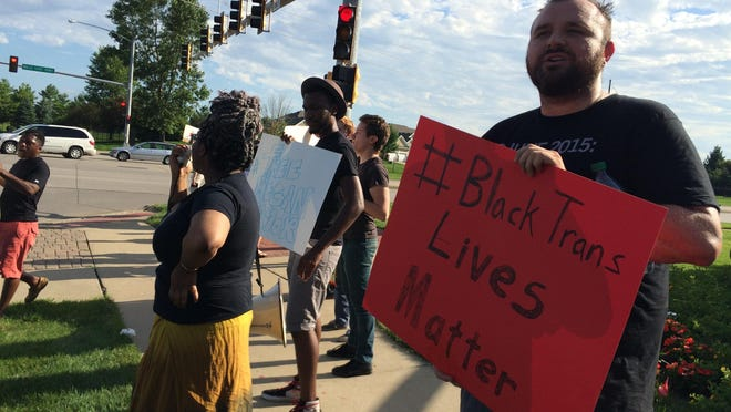 """Protestors chanted """"Black lives matter"""" and """"Trans lives matter"""" at the corner of Mills Civic Parkway and South Prairie View Drive on Saturday evening."""
