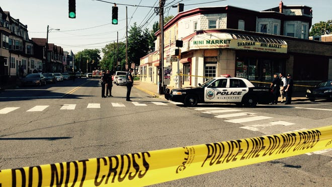 Police respond to a shooting at the intersection of Concord Avenue and Washington Street early Saturday night.