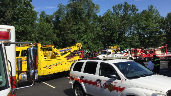 "Tow trucks and emergency-service vehicles line up behind Par-Troy Funeral Home in Parsippany Monday July 20 for the funeral of beloved former Hanover tow-service operator, Robert Paul ""Butch"" Hubert, who died on July 14. The trucks joined a funeral procession that include Hubert's casket on a flat-bed tow truck."