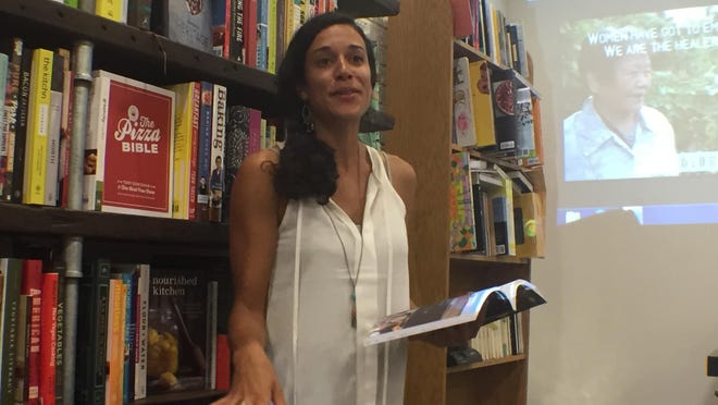 """As a young activist in the local food movement, Natasha Bowens found few faces like hers. Her nationwide search to document minority farmers and their food justice struggle resulted in her book, """"The Color of Food"""" and her reading July 22 at the Morris Book Shop in Lexington."""