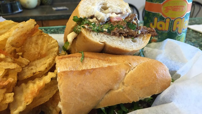 The chorizo stew and Torta sandwich are paired with Jai Alai from Cigar City Brewing.