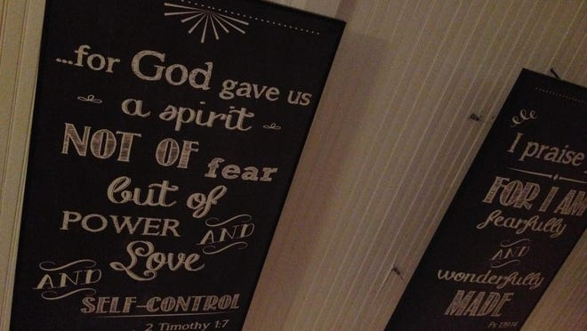 Biblical verses written on the ceiling of the Yoga4Him hot yoga studio, located in Wetumpka