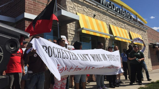 Fast-food workers and their supporters rally for higher wages recently outside a McDonald's at Culver Road and East Main Street.