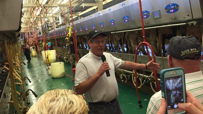Dairy producer Lynn Boadwine talks about his milking operation near Garretson on Thursday.