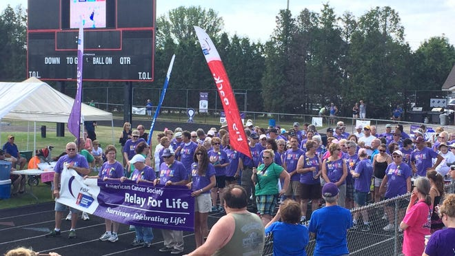 Cancer survivors lead the pack at the 2015 Manitowoc Relay for Life.