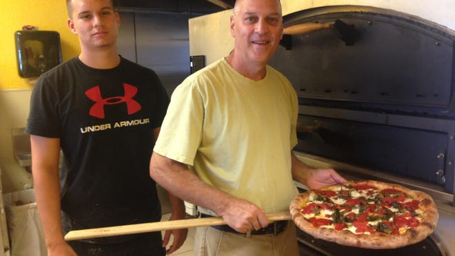 Owner Joe Calderone with his son, Robert, at Joe Daddy's Pizza in northeast Cape Coral.