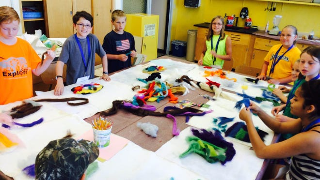 """Campers play with dyed wool in """"Painting with Wool."""""""
