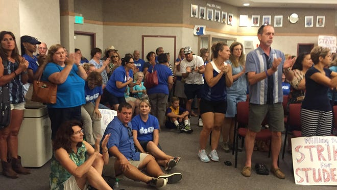"""Teachers from DSUSD chanted """"strike for kids"""" at Tuesday's board meeting."""