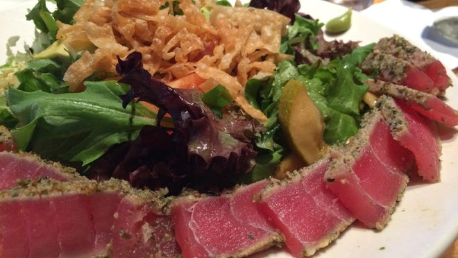 BJ's Seared Ahi Salad features baby greens, Napa cabbage, avocado, quick-pickled cucumbers, rice-wine vinaigrette and squares of perfect ahi tuna.