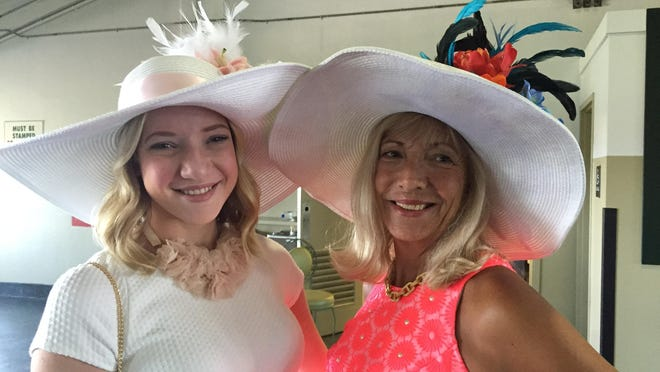Wall residents Mackenzie Turner (left) and her mom Laura Turner show off their hats at the Haskell.