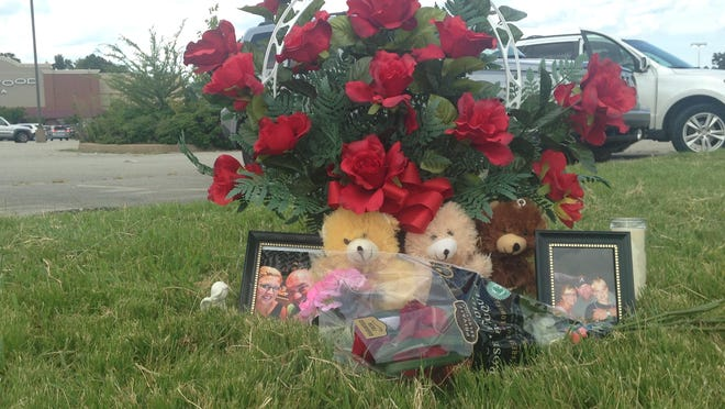 A memorial sits at the entrance of the Hollywood Cinemas theater on Vann Drive honoring Jay and Julie Hogan.