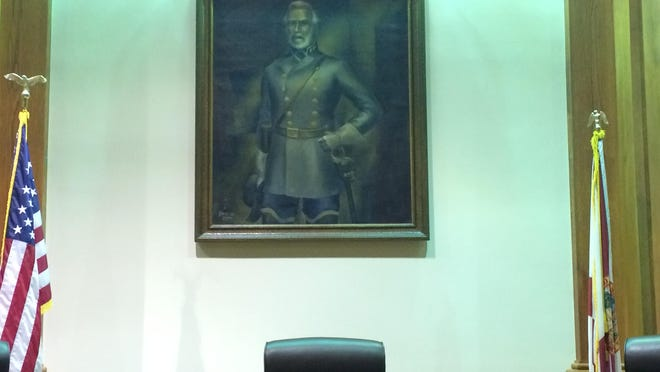 This portrait of Confederate General Robert E. Lee hangs behind the Lee County Commissioners in the commission chambers. The president of the local NAACP chapter has requested its alteration or removal.