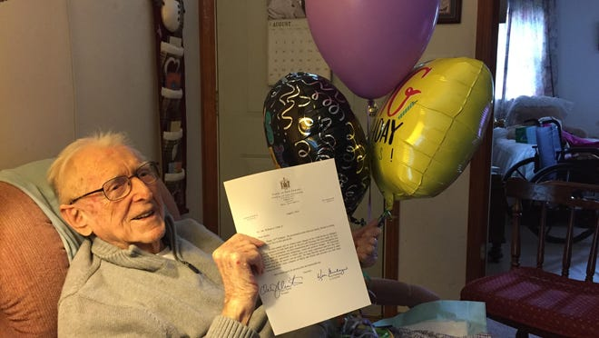 "William ""Austin"" Clark holds a letter from Gov. Christie congratulating him on his 105th birthday."