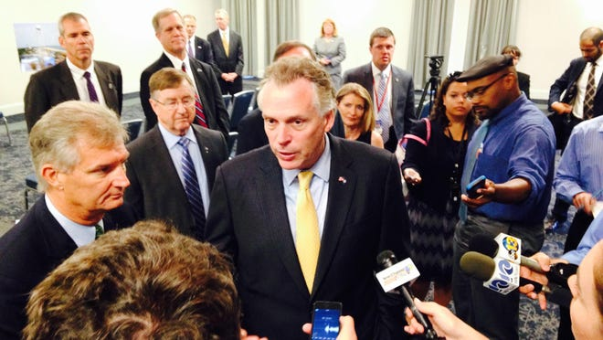 Virginia Gov. Terry McAuliffe fields questions from reporters Thursday in Norfolk about the state's new agreement with NASA and Orbital ATK.