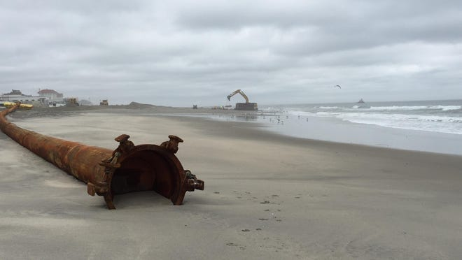 Piping for the Army Corps of Engineers beach replenishment project rests on the beach in Loch Arbour earlier this year.