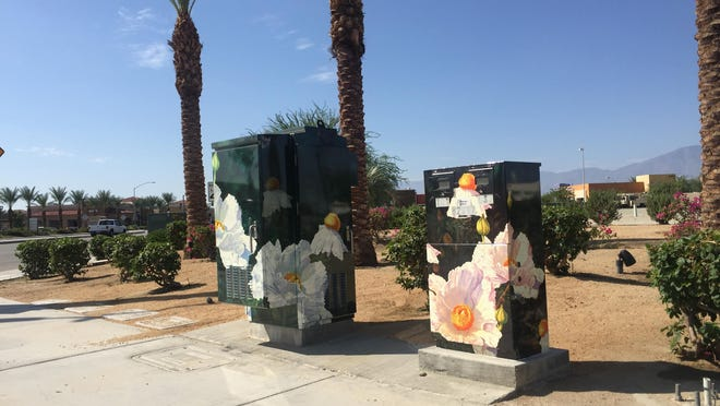 Decorated utility boxes sit at the corner of Avenue 42 and Jacksin Street in north Indio.