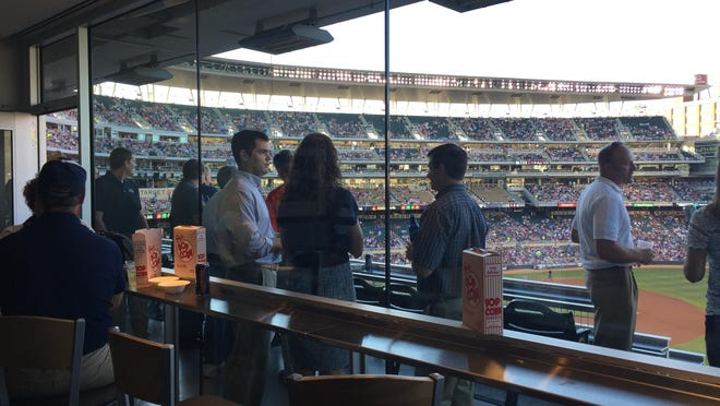 Economic developers from Sioux Falls and South Dakota mingle with business prospects at Target Field in Minneapolis.