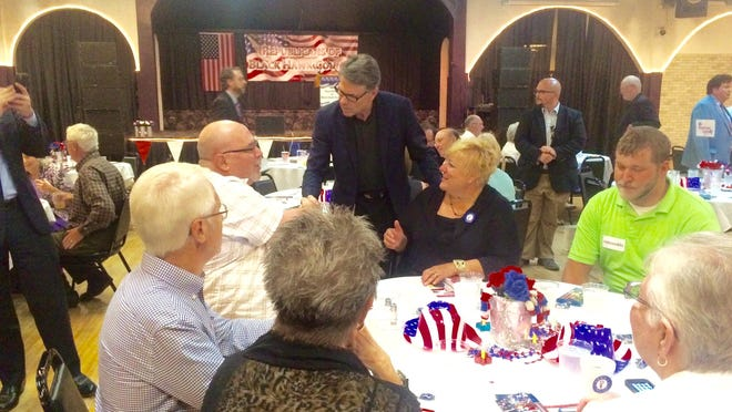 Former Texas Gov. Rick Perry mingles Sunday at the Black Hawk County GOP Lincoln Day Dinner in Waterloo.